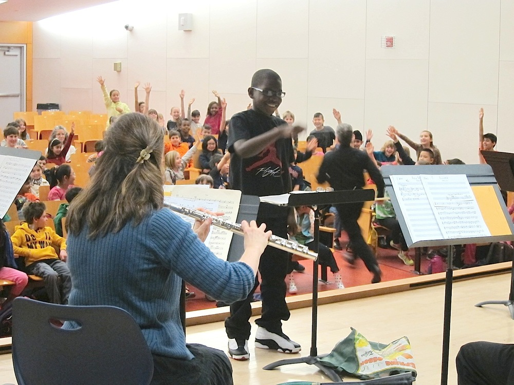 A young boy conducts the KCO at one of our Youth Outreach visits.