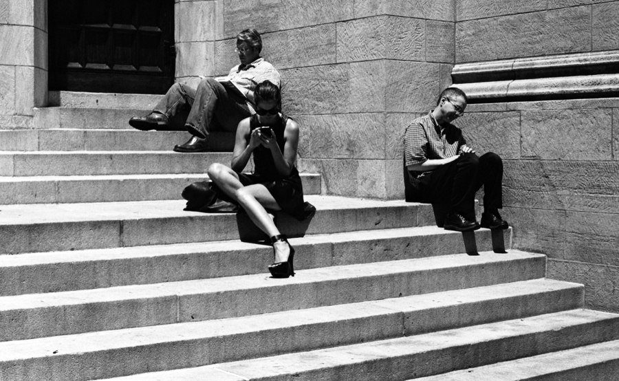 three_people_sitting_on_church_steps.jpg