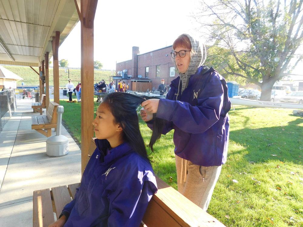 Real teammates braid each others' hair.