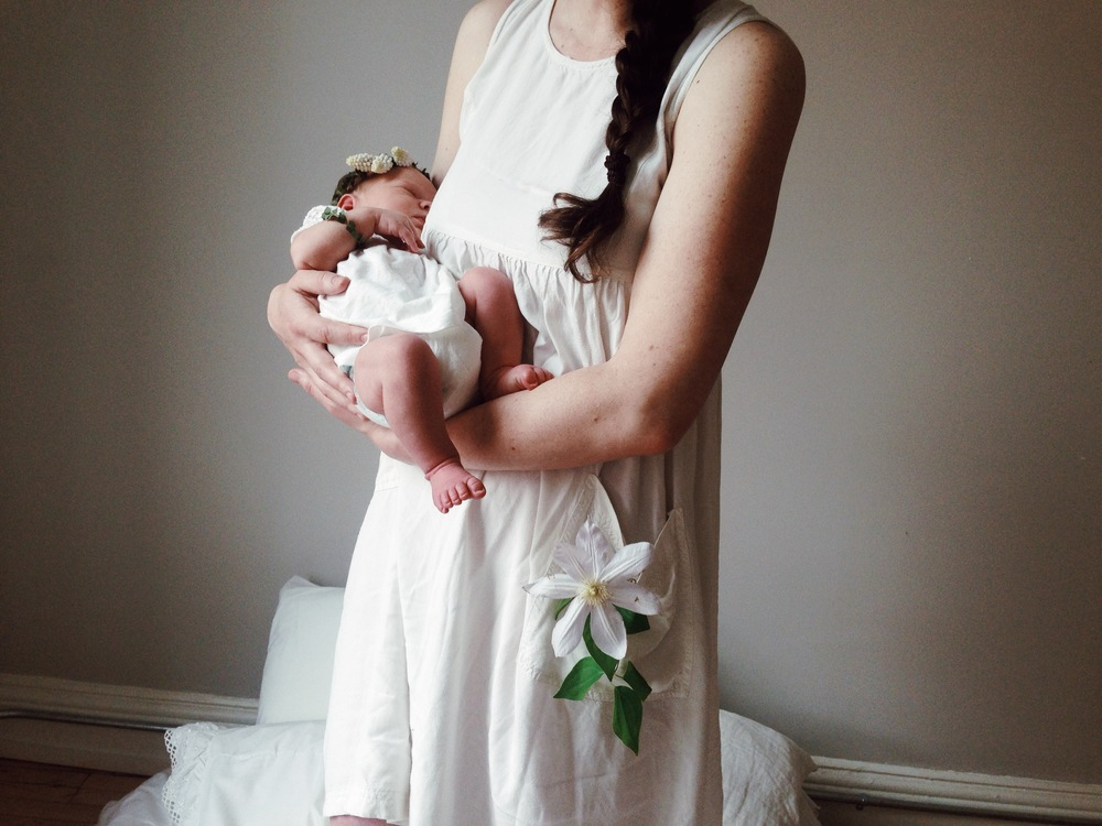 a behind the scenes shot of a newborn shoot I did the floral styling for
