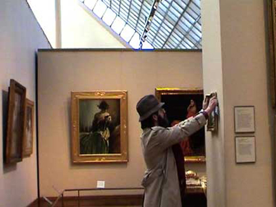 Banksy In Disguise Putting Painting In Museum