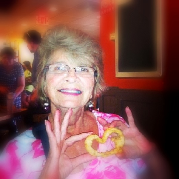 My sweet friend Connie who was on the heart transplant waiting list when she found this heart shaped onion ring.  - Houston, TX, 2011