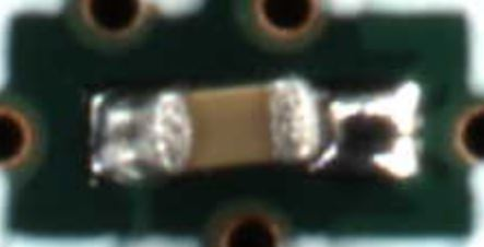 """This is what a """"Head-In-Pillow"""" defect looks like. Notice how the right side isn't actually wetted to the component."""