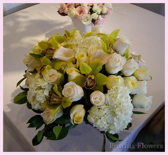 White hydrangea, vendella and crem de la creme roses with mini white callas.jpg