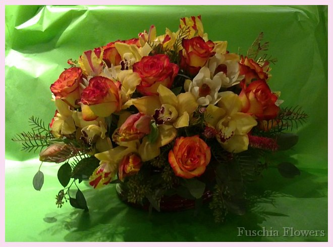 circus roses, golden cymbid orchids, parrot tulips and leucadendron.jpg