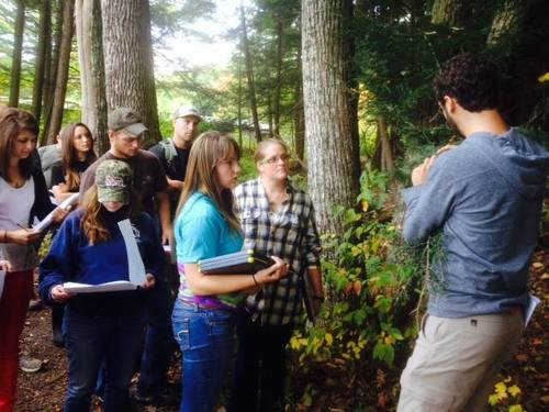 Dan Snider, Catskill Regional Invasive Species Partnership (CRISP) Field Projects Manager, leads a student group through invasive plant identification training.