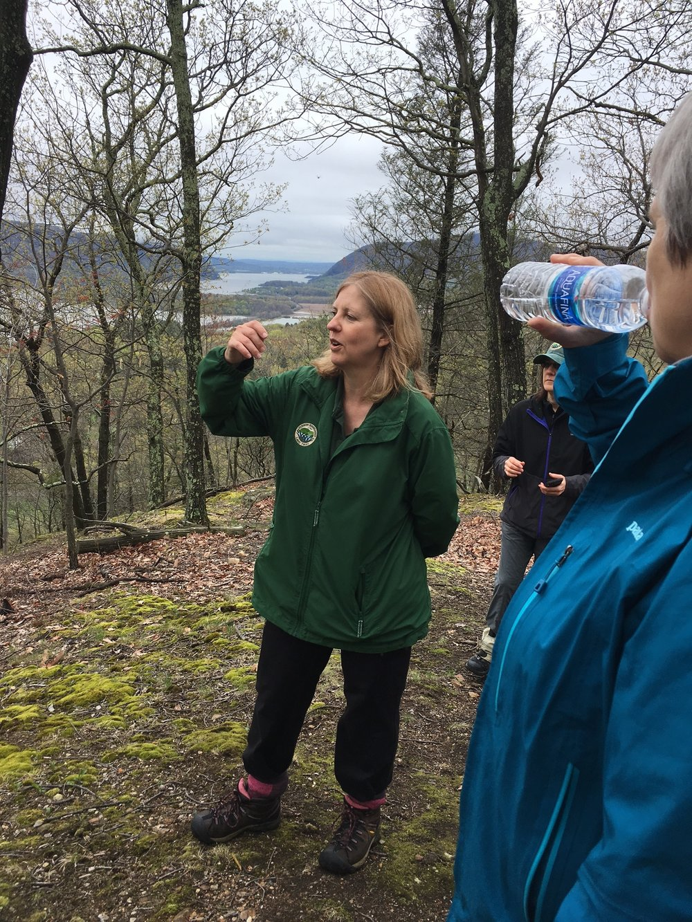 Michelle Smith, Executive Director of Hudson Highlands Land Trust, points out Constitution Marsh and West Point from the North Redoubt