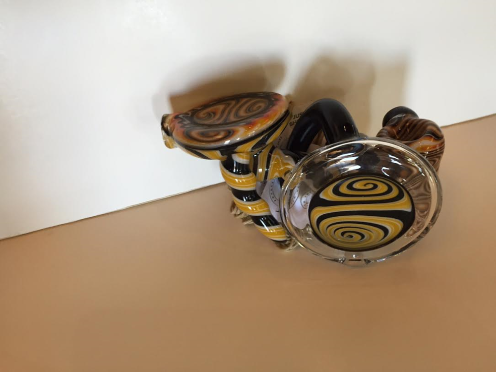 This is a very rare glass water pipe made by a local artist in Rochester, NY.  It is quite eye catching and constantly gets asked about.  Stop in today to see how magnificent it is in person.