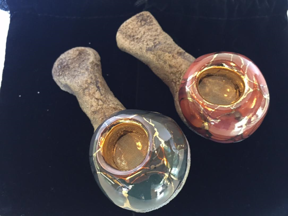 "These rare pipes are called ""celebration"" and were made by an artist in Maui, Hawaii. Magnificently stunning, .  Polished to perfection with gold inlay and made from lava, these pieces are more art than tool."