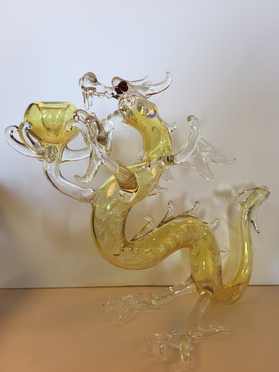 Another local Rochester NY artist piece.  This glass dragon stands tall and proud, holding a glass bowl.  The tail is the pipe stem.  Probably one of the more intricate pieces we carry.  Very cool and very rare.