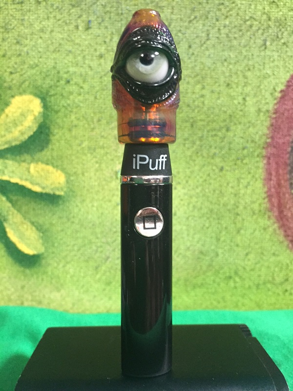 A limited edition iPuff Bard handheld vaporizer with a unique glass eye dome. Each dome is hand made in Leadville Colorado by glass blowing artist Michael Bard. No two domes are the same making each one unique and one of a kind.  Hand blown and hand signed.