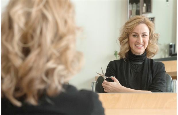 light-skinned person holding scissors
