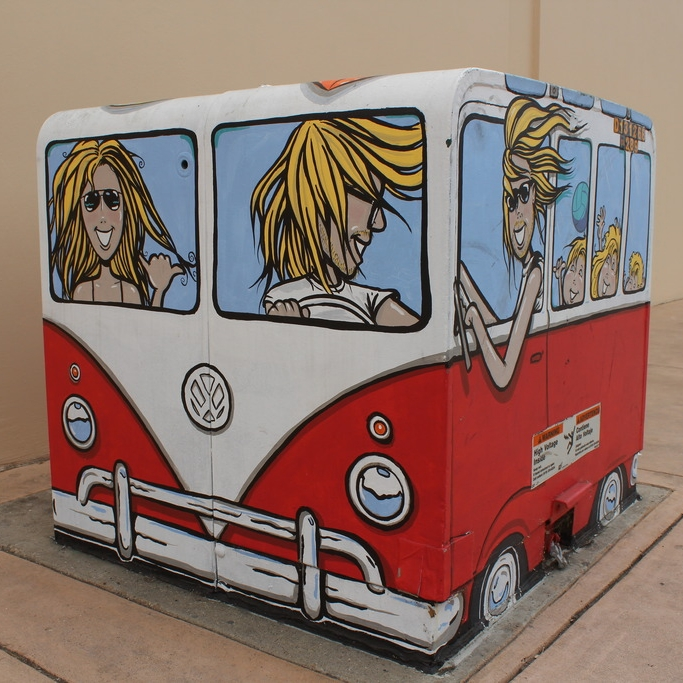 Next up on our tour, hold onto your hat, because this family van is headed to the beach!  Artist: Steve Burrows