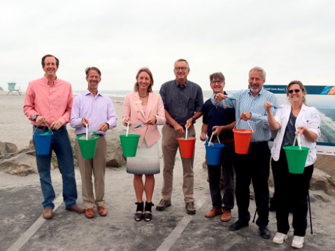 Elected officials and project team members from Caltrans, SANDAG, California State Parks, the ASBPA, and the San Elijo Lagoon Conservancy celebrate the completion of the sand replenishment work on Cardiff State Beach in Encinitas and Fletcher Cove in Solana Beach.