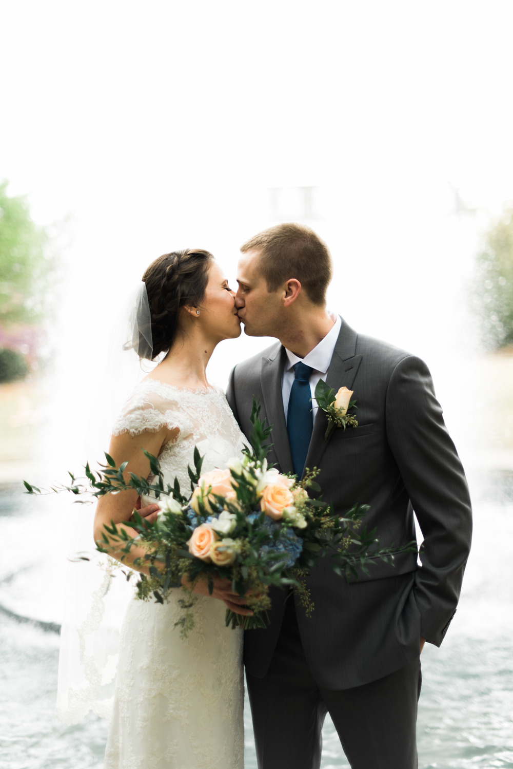 bride and groom fountain uga athens wedding photographer