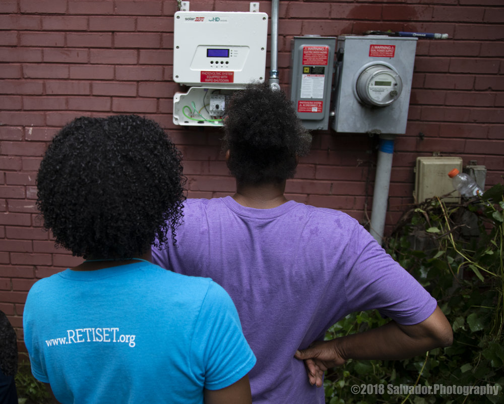 Sharon and DeAndrea: observing her new meter for her rooftop solar system