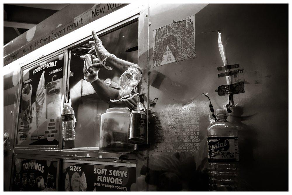 Street Vendor with Camera Phone  Brooklyn, 2016