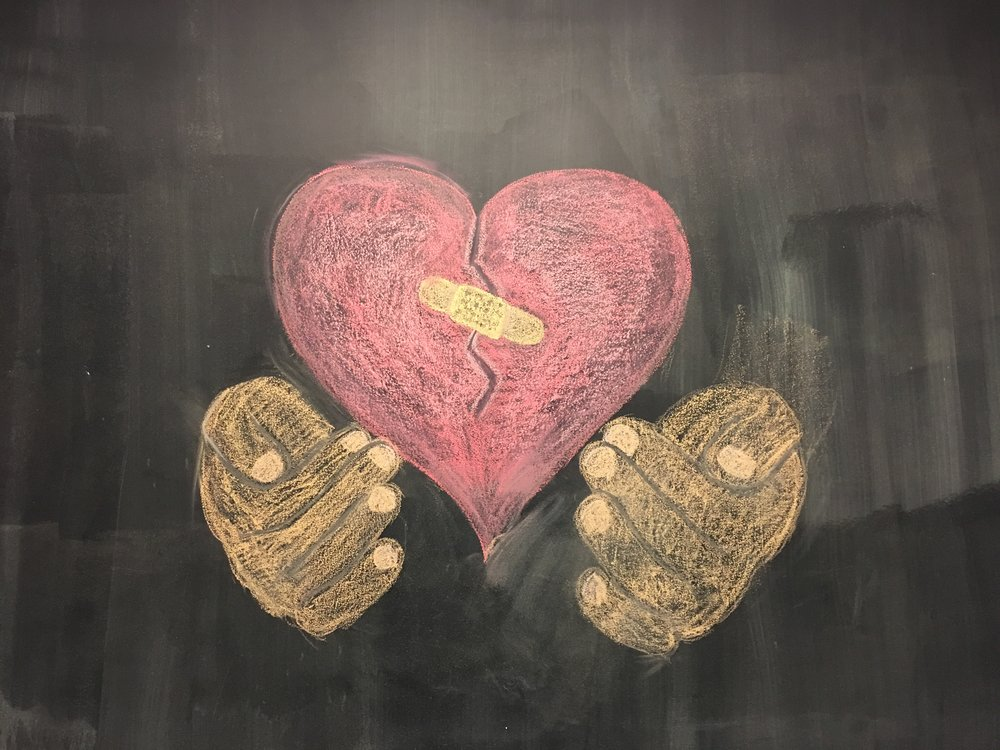God is holding our hearts in His hands. Chalk drawing by Riley Jones