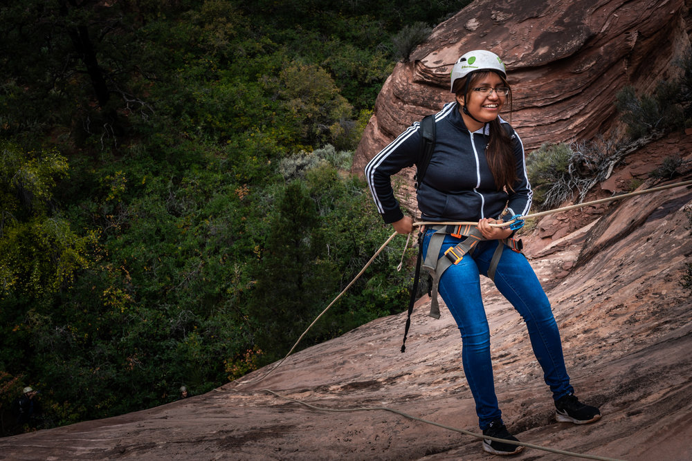 Adrienna rappelling in Zion National Park. PC: Josef Kissinger