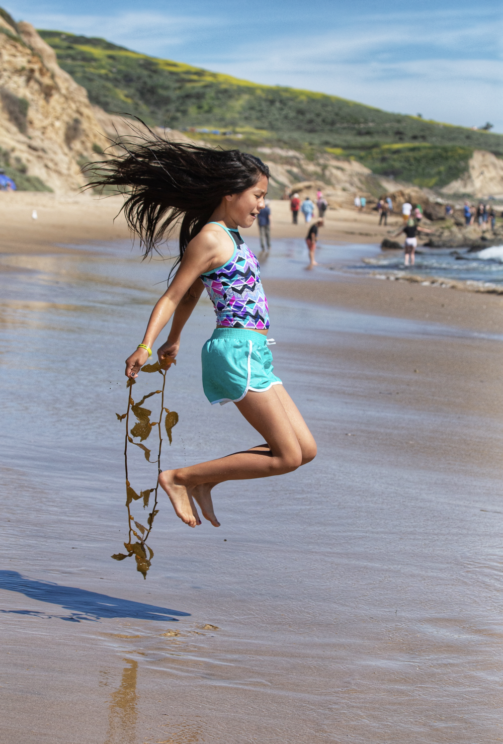 Memphis jump ropes with seaweed at Laguna Beach, CA. Photo taken by Anita Ojeda.