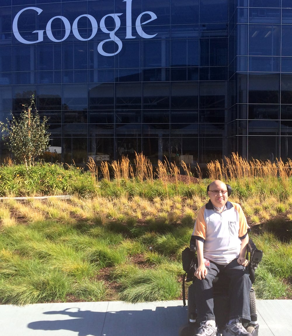 Jason Chu posing outdoors in front of a Google office building in Mountain View, California
