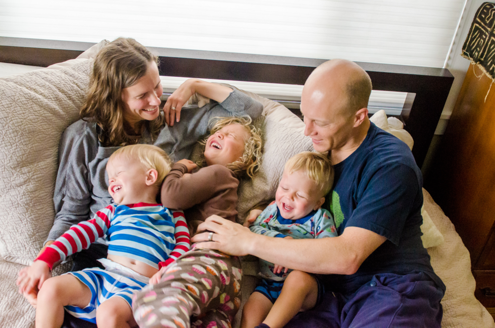 family laughing snuggles