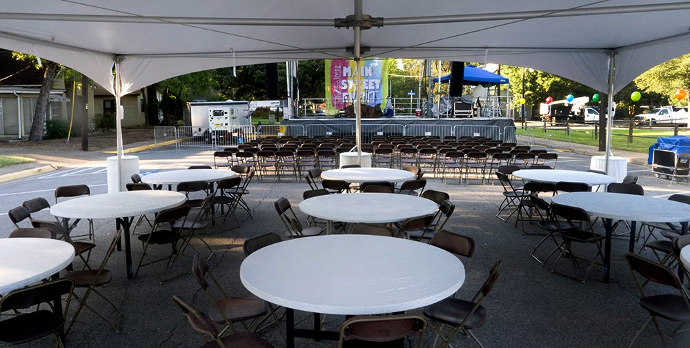 white tables and chairs set up.