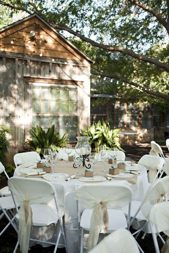 white samsonite chairs set up using burlap and white linen.jpg