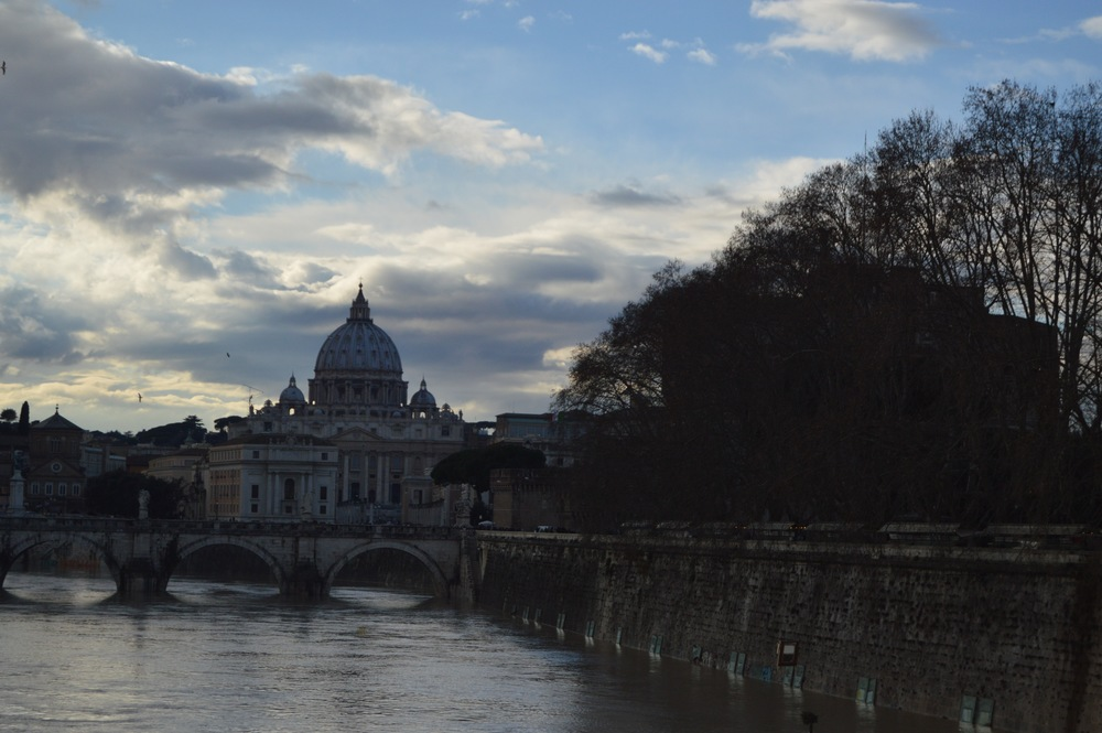 Zoomed in view of St. Peter's Basilica from across the Tiber. Photo by Max Siskind.