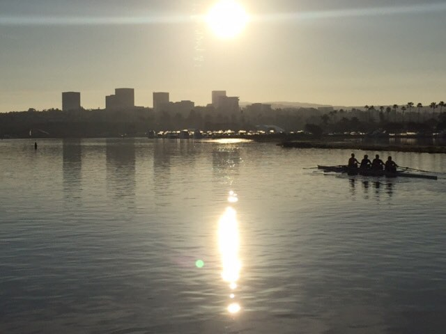 #flashbackFriday  to Deborah going for a row with her team right in our back yard on the Newport Back Bay - with Fashion Island in the background! #dkfindshomes