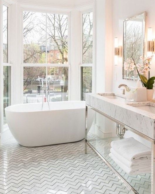 Who else loves the features in this gorgeous bright bathroom!  #homesbydkcowles   #dkfindshomes