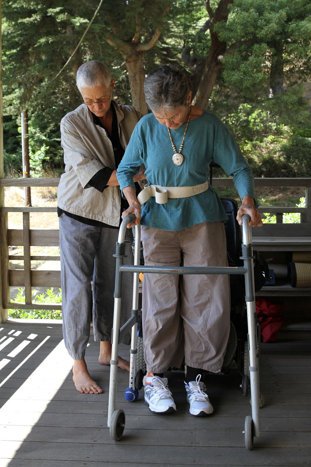 "Nancy ""Fu"" Schroeder assists her partner, Dr. Grace Dammann, with her physical therapy routine at their home at Green Gulch Farm Zen Center in Marin, California. Dammann survived a near-fatal head-on collision on the Golden Gate Bridge in 2008. The new feature-length documentary  States of Grace  by filmmakers Helen S. Cohen and Mark Lipman follows Dammann and her family in the wake of the accident. Photo credit: Mark Lipman"