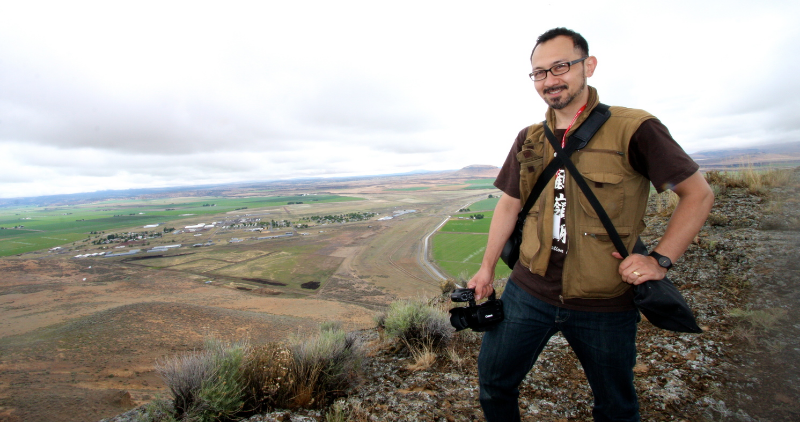 Director Konrad Aderer at top of Castle Rock Mountain overlooking Tule Lake Segregation Center site