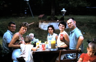 Robert's family enjoy a backyard barbecue when he was a boy- 1965 hospitality