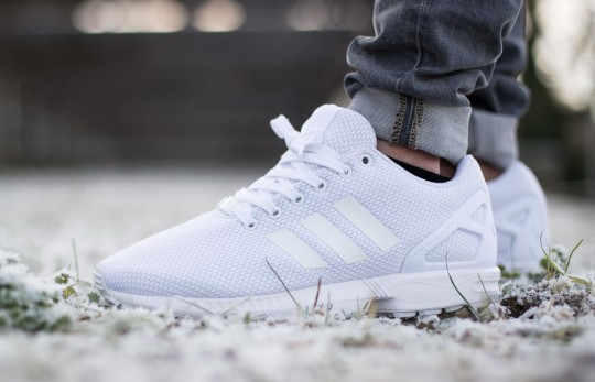 triple white zx flux on feet