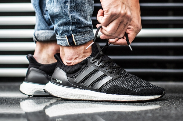 core black adidas ultra boost on foot