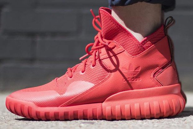 all red adidas tubular x on foot