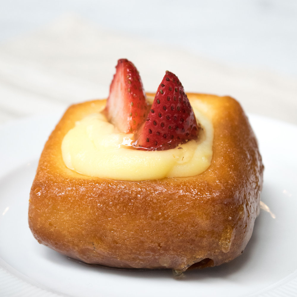 Babà al Rum , a traditional Italian dessert, is a dark- rum-soaked brioche filled with pastry cream + topped with fresh strawberries. See more -->