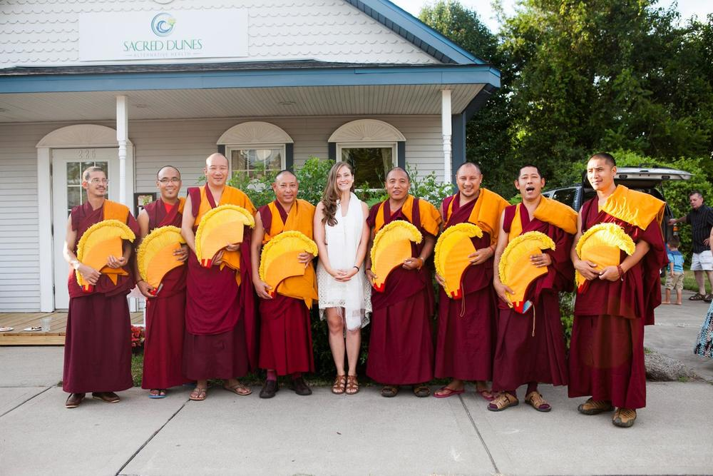 Sacred Dunes Alternative Health being blessed by Tibetan monks during its grand opening ceremony