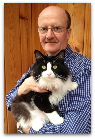 Dr. Hugh Chisholm with Tuxedo Stan (Image: Tuxedo Party of Canada Cat Welfare Society)
