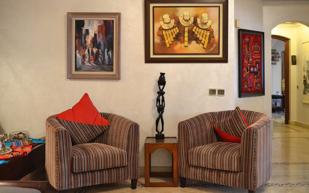 Local and international art lends eclectic elegance to unify the entire home.