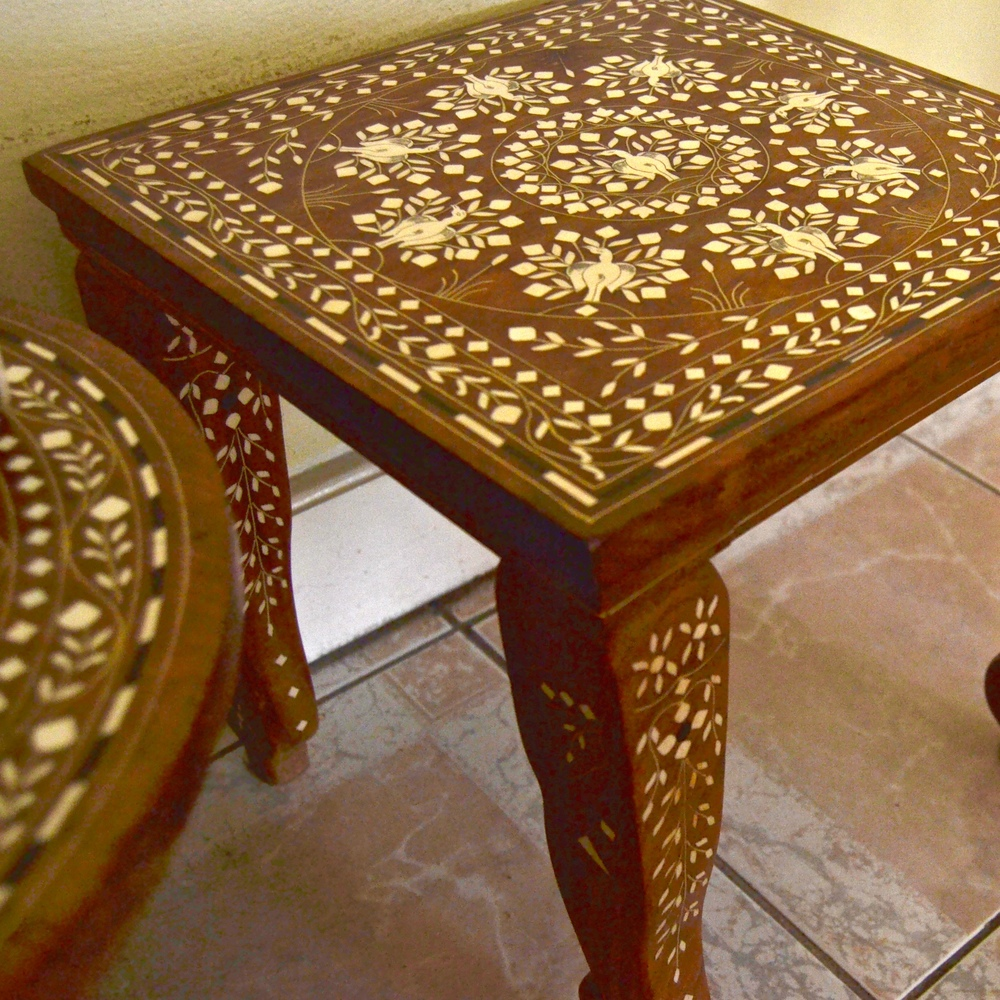 Inlaid side tables from Panama and India.
