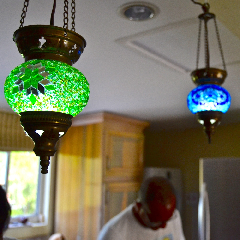 Lamps from Turkey bring extra light and color to the kitchen.