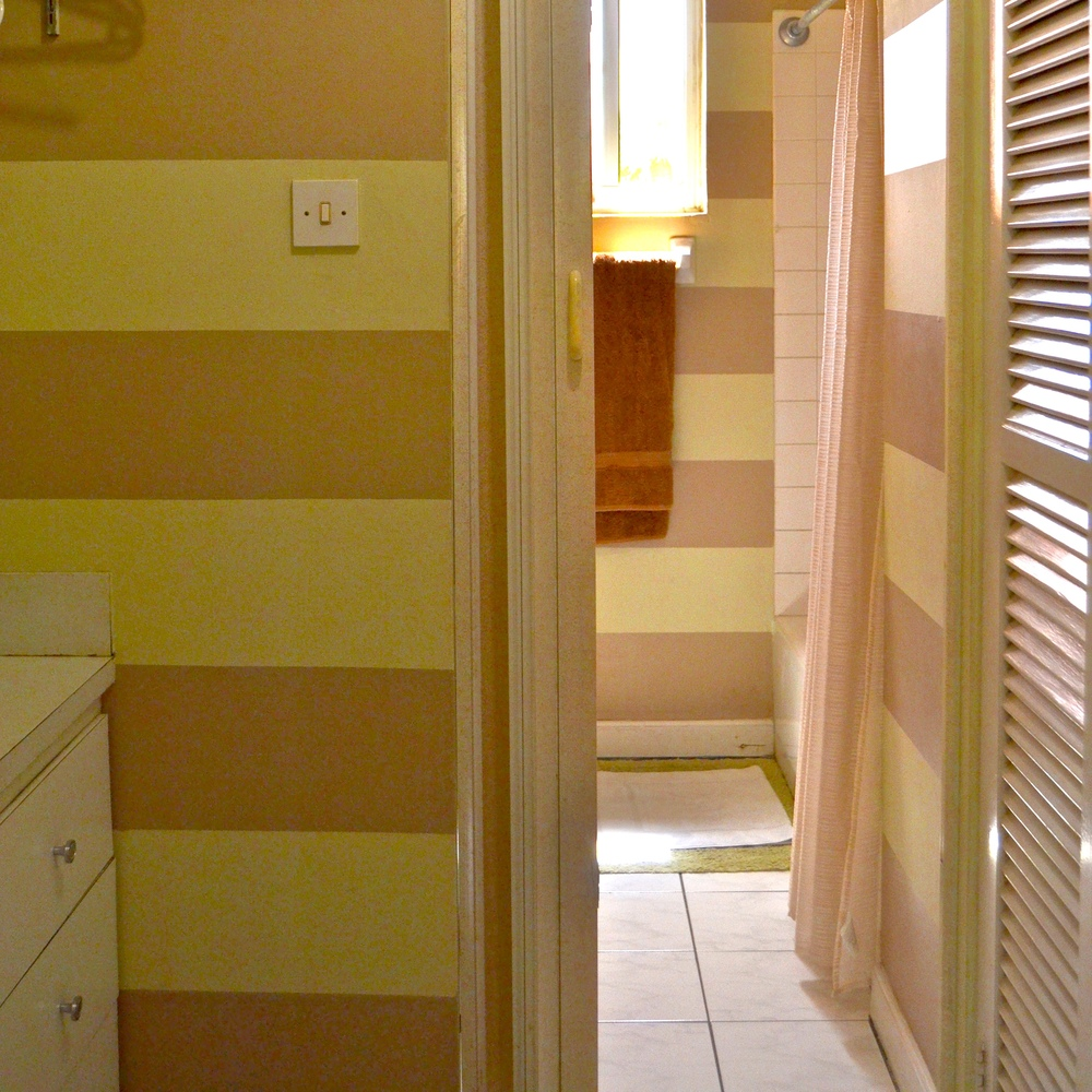 Design ideas, like striped painting in the bathroom, are a collaboration with daughter Bethany.