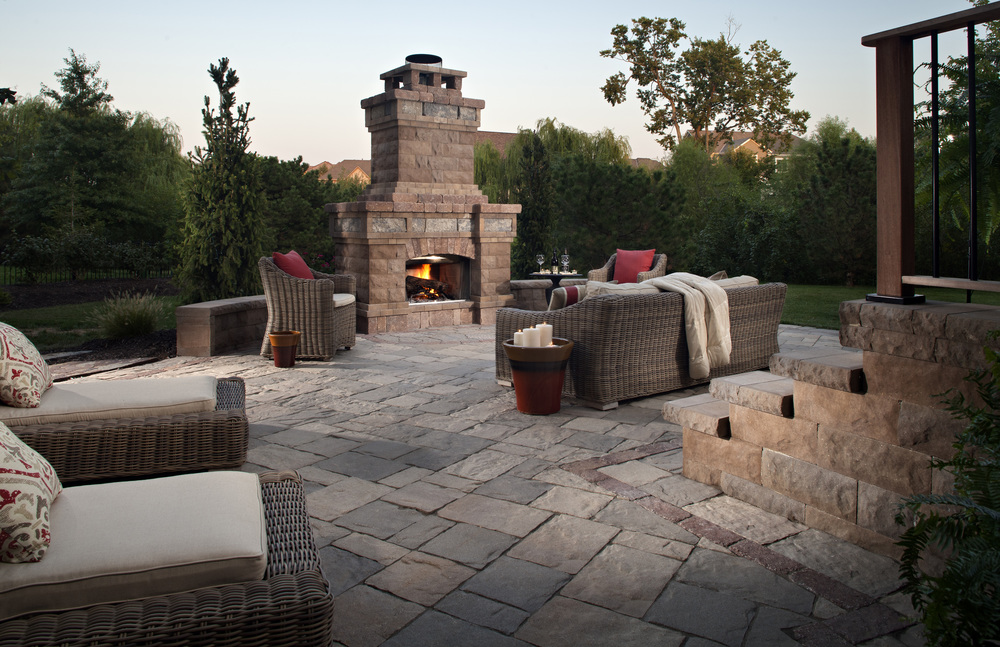 This amazing outdoor room uses products by Belgard Hardscapes to define the style and form.