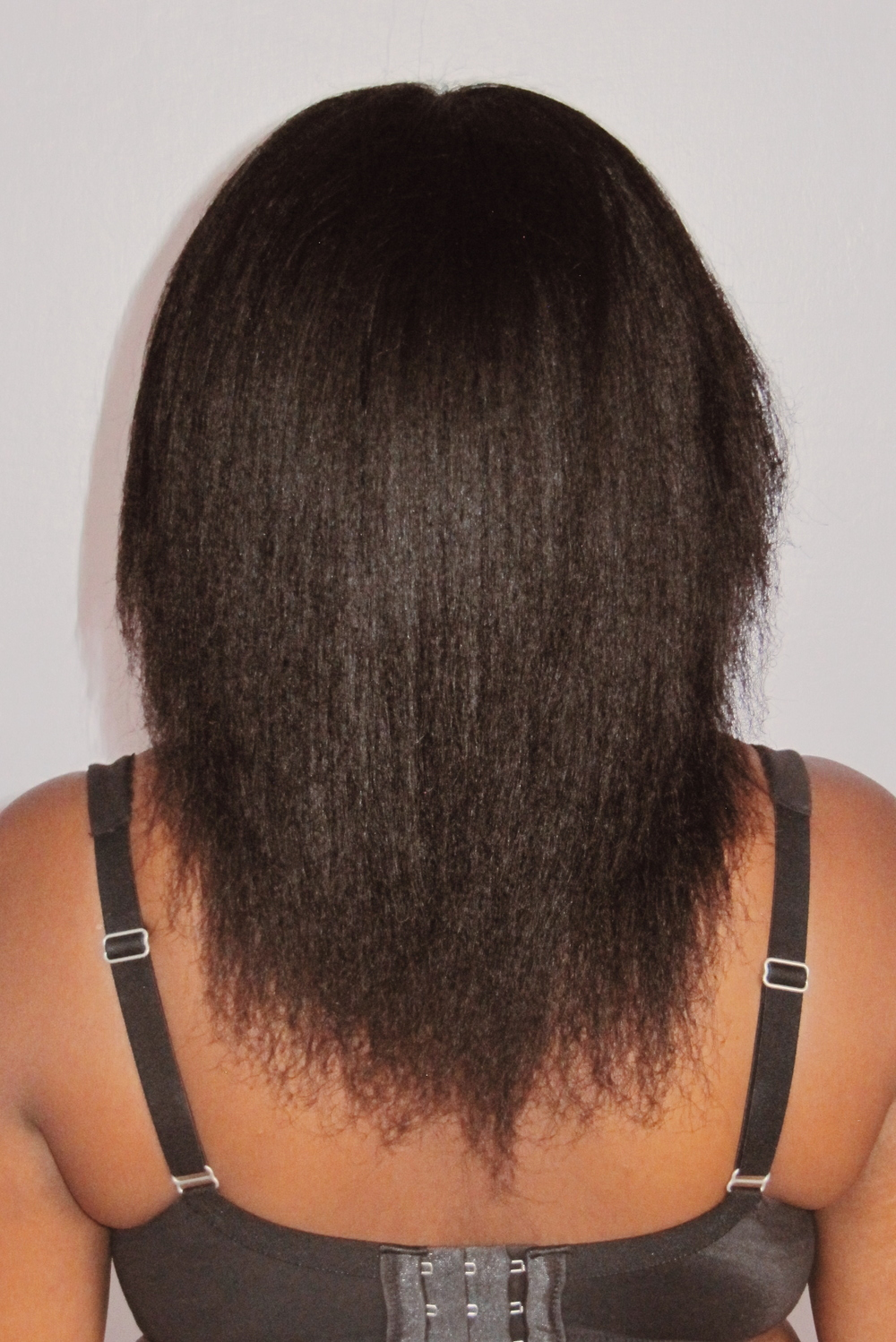 If you're new to the natural hair community, don't be surprised by this shot. One of the ways to measure hair growth is by progress made down your back. This shot captures some SERIOUS SPLIT ENDS, but also my length. I was squarely at the mid-point between shoulder length and armpit length.