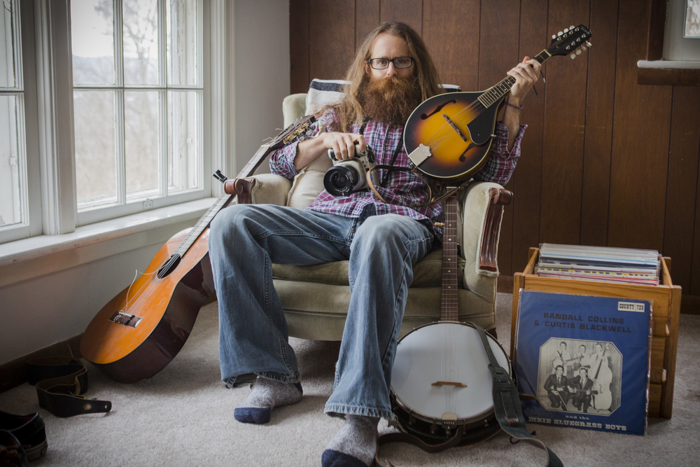 Josh Birnbaum, a photographer and musician, in his Athens, Ohio, home on Jan. 23, 2015. Birnbaum recently received funding for a project to document bluegrass music culture in Appalachia on film.