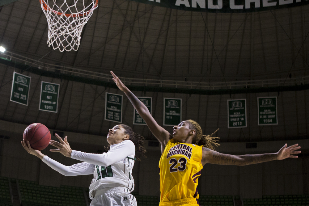 Ohio junior forward Lexie Baldwin, left, attemps a layup against the defense of Central Michigan guard Crystal Bradford, right, at the Convocation Center in Athens, Ohio, on Jan. 17, 2015. Ohio won 71-51.