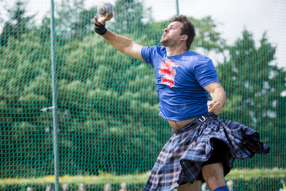 A heavyweight throws in the shot put event at the St. Andrews Highland Games in Scotland on July 29, 2015.