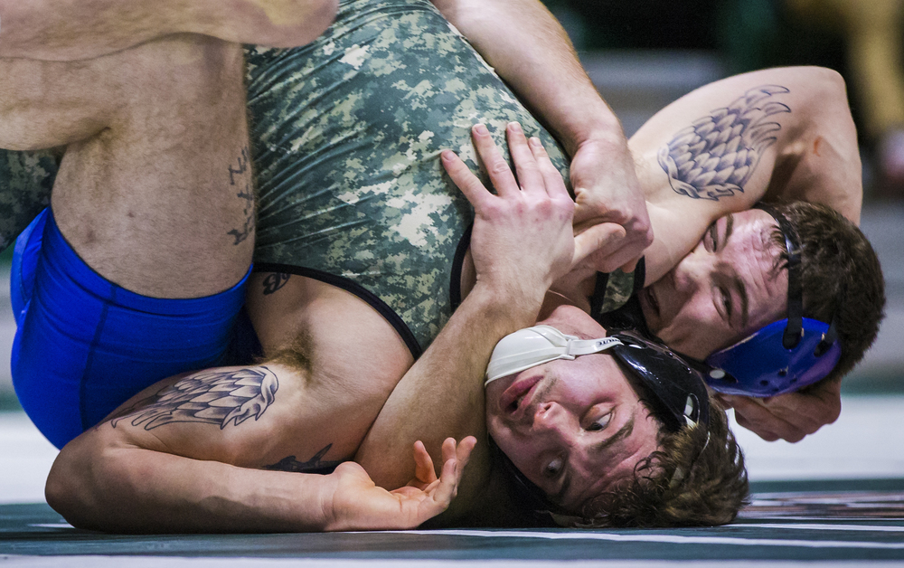 Ohio University redshirt junior Cody Walters battles with SUNY Buffalo wrestler Wally Maziarz in the Convocation Center in Athens, Ohio, on Jan. 25, 2015. Walters won in a 2-0 decision. Ohio won overall 24-13.
